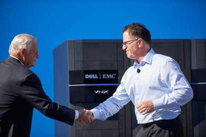 Joe Tucci - CEO, EMC and Michael Dell - CEO, Dell shake hands on the $US67 billion merger