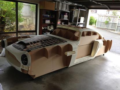 """Since last December, Ivan has been hard at work, putting together a plastic replica of an Aston Martin DB4—the precursor model to James Bond's famous DB5—made of enough 3D-printed parts that Ivan calls it a """"2500-bit jigsaw puzzle."""""""
