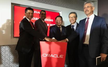 L-R: Zainal Amanshah (InvestK); Cherian Varghese (Oracle); Darell Leiking (Minister of international trade and industry); Michael K C Yam (InvestKL) and Mohamed Fitri Abdullah (Oracle)