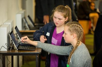 Students use Lenovo tablets at Deakin University on 25 June