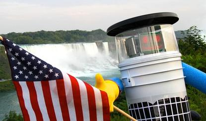 Canadian hitchhiking robot HitchBot poses in this promotional image distributed by Ryerson University for the robot's journey from Massachusetts to California.