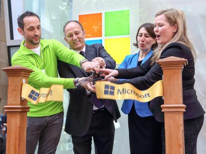 The ribbon is cut to mark the official opening of Microsoft's flagship store in Sydney.  L to R: Sydney Flagship Store manager, Nick Wells;  Microsoft corporate vice-president of marketing and operations, Peter Cray; New South Wales treasurer, Gladys Berejiklian; Microsoft Australia managing director, Pip Marlow.  Photo by MIKE GEE.