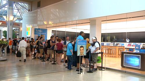 About 30 people waited for the opening of the Microsoft store in Boston on July 29, 2015.