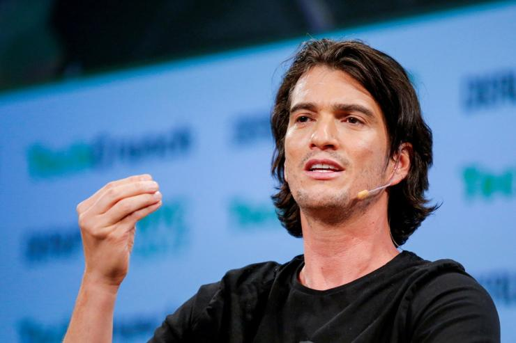 Adam Neumann, CEO of WeWork, speaks to guests during the TechCrunch Disrupt event in May 2017
