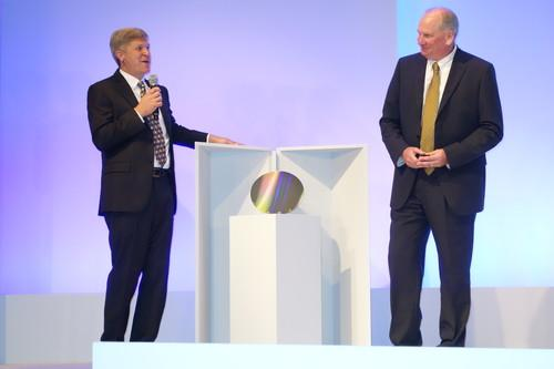Rob Crooke, senior vice president and general manager of Intel's Non-Volatile Memory Solutions Group, left, and Micron CEO Mark Durcan unveiled the first wafer of the 3D XPoint memory technology the companies co-developed, in San Francisco on July 28, 2015.