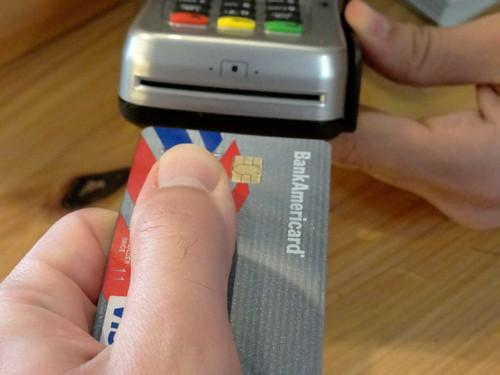 A chip-enabled credit card, inserted into a store's reader.