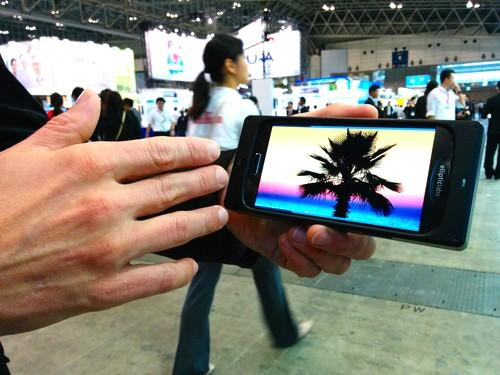 Elliptic Labs shows off its smartphone gesture control interface at Ceatec 2014 outside Tokyo on Tuesday. The system uses an ultrasonic speaker to determine the location of a user's hand.