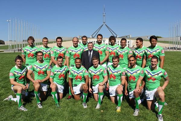 The Canberra Raiders in 2012 with Huawei Australia chairman John Lord.