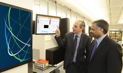 Dr. Robert Darnell (left) of the New York Genome Center and Dr. Ajay Royyuru (right) of IBM Research discuss initiative to accelerate a new era of genomic medicine with the use of IBM's Watson cognitive system. IBM and NYGC will test a unique Watson prototype designed specifically for genomic research as a tool to help oncologists deliver more personalized care to cancer patients.