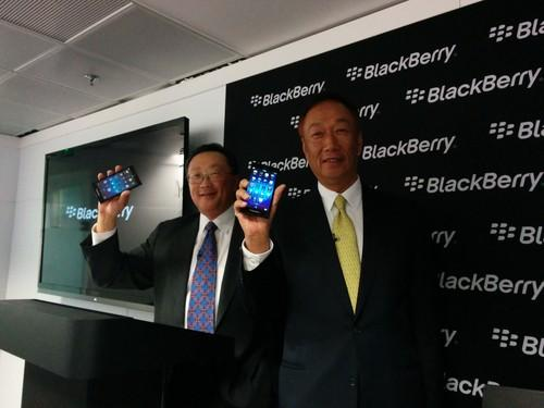 BlackBerry CEO John Chen (left) and Foxconn CEO Terry Gou show a new sub-$200 BlackBerry phone due on sale in April, at Mobile World Congress 2014 in Barcelona on February 25, 2014