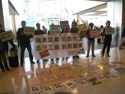 Labor protection group SACOM holds a protest outside an Apple store in Hong Kong.