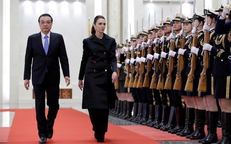 China Premier Li Keqiang and New Zealand Prime Minister Jacinda Ardern attend a welcome ceremony at the Great Hall of the People in Beijing
