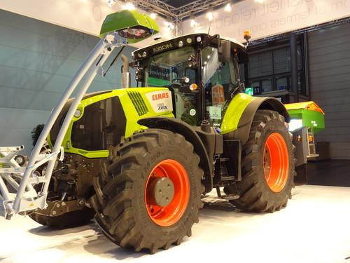 This Claas 830 Axion tractor at Cebit 2015 steers itself using GPS, and reports crop health using data gathered from infrared sensors on the boom at the front. It weighs over 7 tonnes and measures 3.2 meters high and 5.7 meters long.