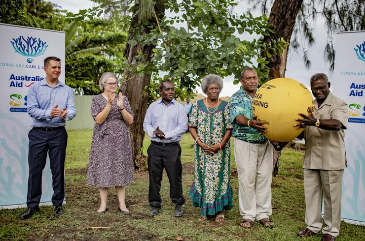 Solomon Islands Prime Minister Manasseh Sogavare (far right) was presented with a symbolic 'golden buoy' to mark the beginning of the Coral Sea Cable being laid between Honiara and Sydney.
