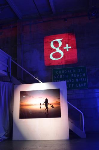 The Google+ logo projected on a warehouse wall during a company event on Oct. 29, 2013.