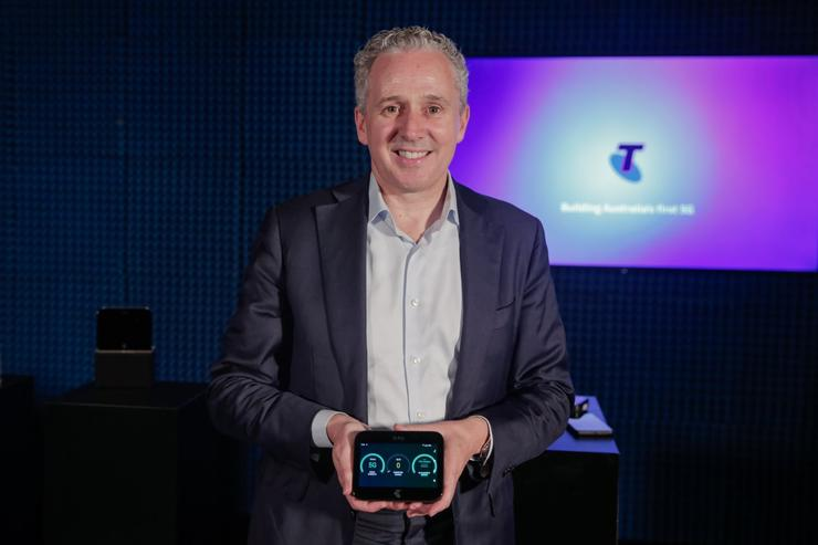 Telstra CEO Andy Pen with the HTC 5G device