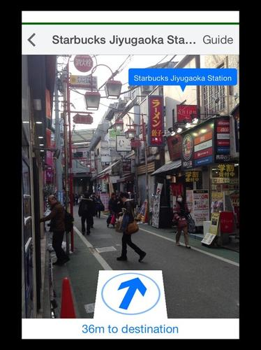 This screenshot from Navitime for Japan Travel shows the augmented reality function pointing the way to free Wi-Fi at Starbucks, tucked behind the buildings on the right.