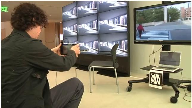 Santiago Alfaro demonstrates Surround Vision technology, which is like a handheld window