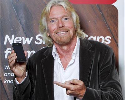 Virgin chief, Sir Richard Branson, in Sydney for a Virgin Money launch — holding an iPhone 4.