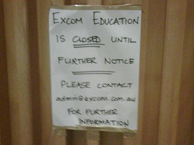 The sign on the doors of Excom's Sussex St, Sydney, offices says it all. Photo: Andrew Morison