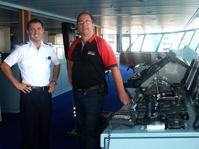 TT Group's Haydn Francis (right) on the bridge of Rhapsody of the Seas