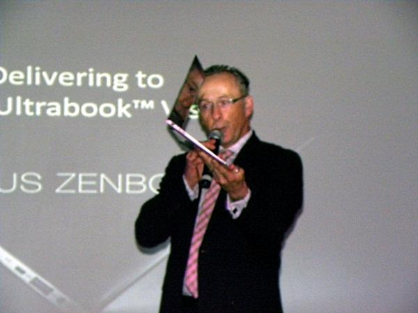 Intel A/NZ general manager, Philip Cronin holds up a Zenbook