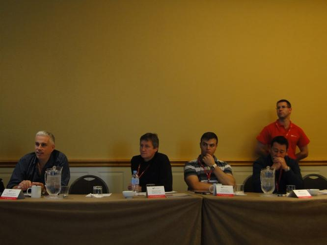 Partners participate in a Q&A session during the conference
