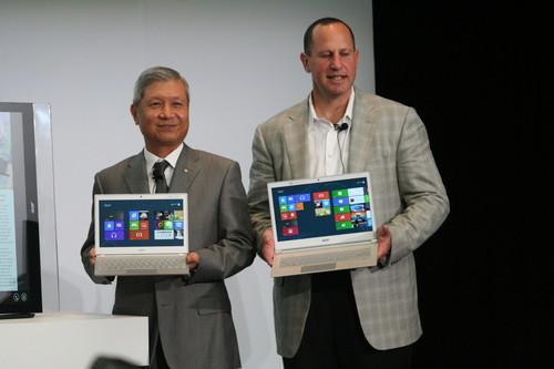 Acer CEO J.T. Wang, and Microsoft's Steve Guggenheimer hold up Acer's latest ultrabooks.