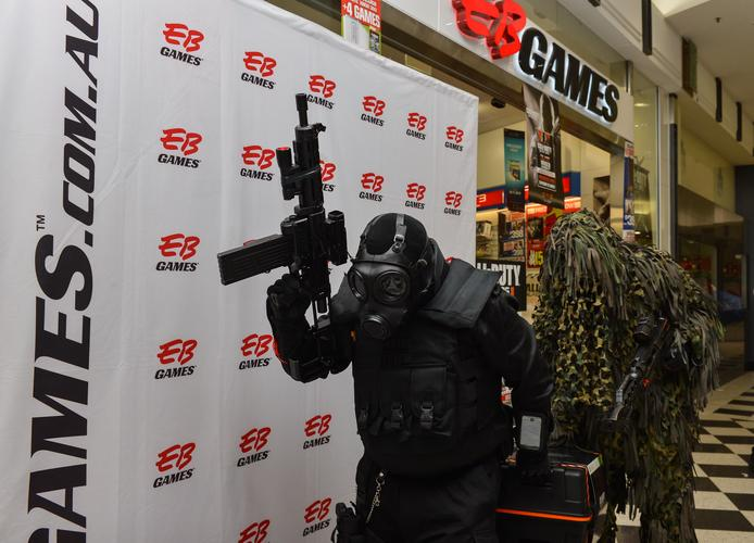 Some Black Ops II characters dressed up and carrying the Hardened Edition of the game.