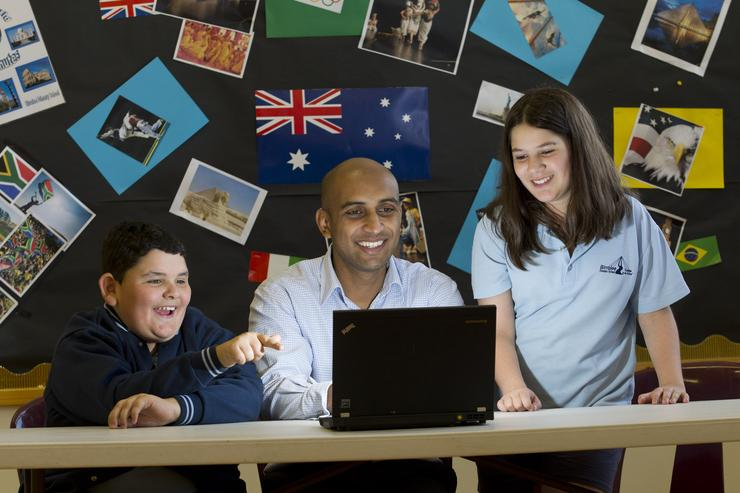 Trend Micro cyber safety expert, Aman Chand (centre), demonstrating safe Internet browsing to two students