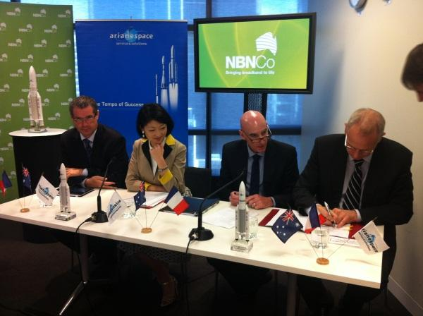 Arianespace CEO, Jean-Yves Le Gall, (right) signs the contract with NBN Co