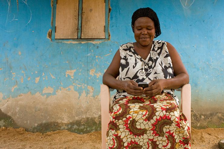 Ghana woman Monica Darkoaa has taught herself how to use a mobile phone to make and receive e-payments. In Australia, the technology will be trialled, starting today, to support Aussie charities deliver their local and global programs. Credit: UNICEF