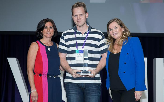 Paul Woods (centre)  accepts the Excellence in Customer Lifecycle Management award for Adopt & Embrace at the Microsoft Australia Partner Awards in 2016.