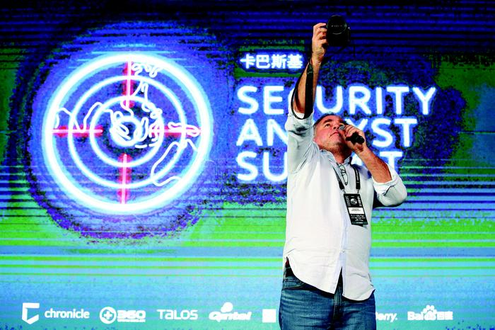 Eugene Kaspersky gets a photo of the Singapore summit audience. Suhaimi Abdullah/Getty Images